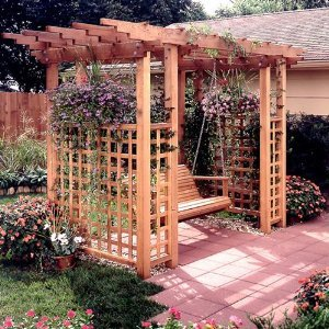 Adding a garden arbor to your garden can create an elegant entryway